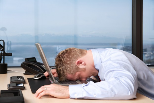 Men lying on the keyboard because of stress